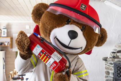 Bjørnis med brannslukningsapparat